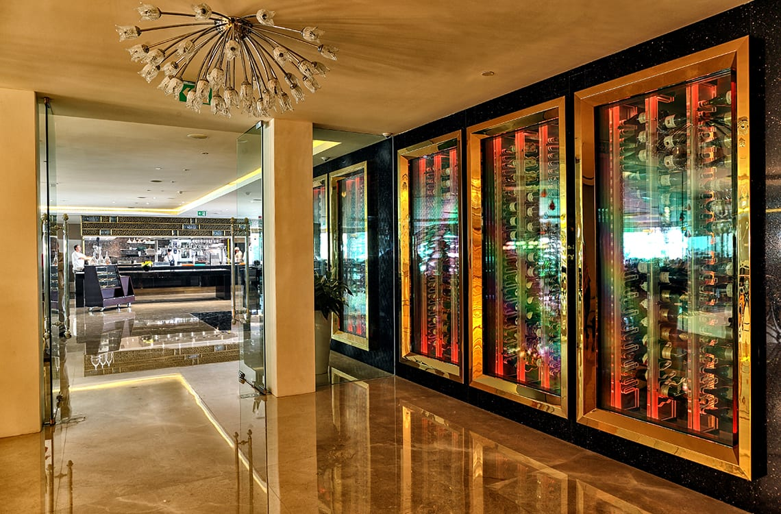 Hotel Wine Cellar with Brass Façade Frames