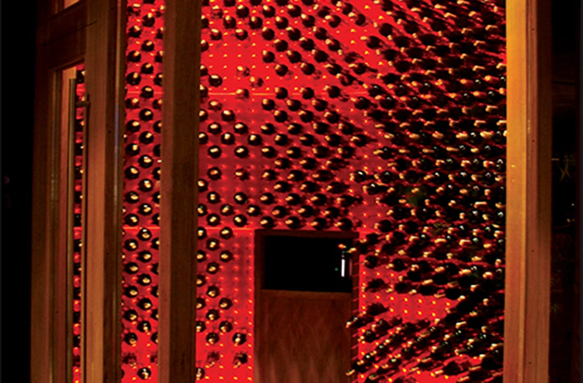 Glass Wine Cellar with Back-lit Wine Wall